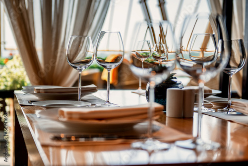 Fotobehang Restaurant Served table with glasses
