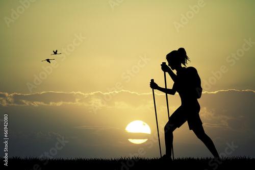 Obraz Trekking at sunset - fototapety do salonu