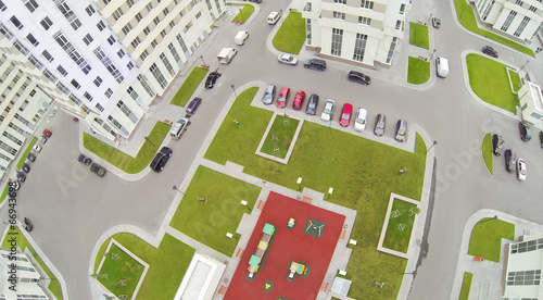 Poster de jardin Route Parking with cars and playground in modern residential complex.