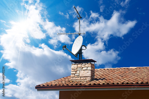 Fotografie, Tablou  Satellite Dish and Antenna TV on Blue Sky