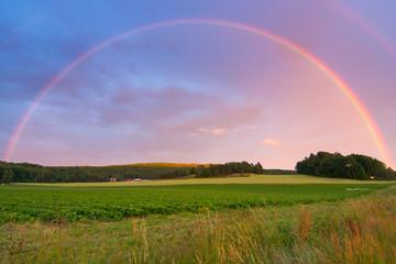 Rainbow over Swedish farm field