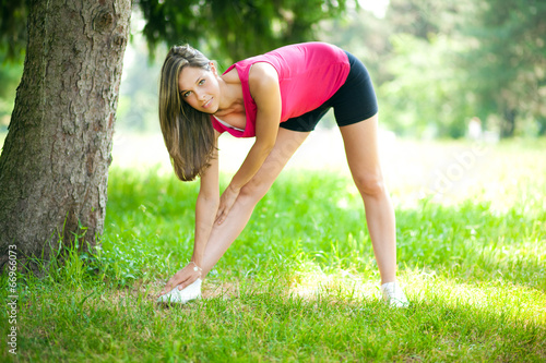 Fotografering  Fitness woman stetching before her workout