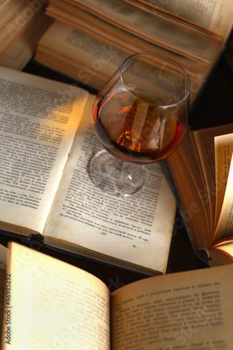 Glass of brandy on books #66985292