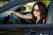 Smiling woman sitting in car, Happy girl driving automobile, out