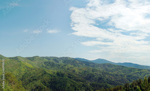 Staande foto Khaki Beautiful alpine landscape with green wooded mountains