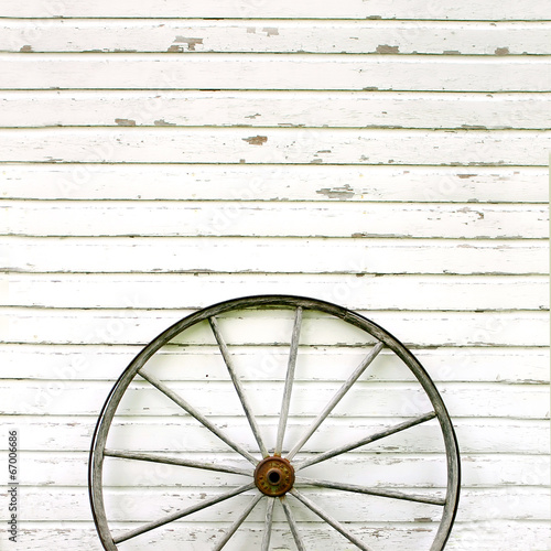 Fotografie, Obraz  Antique Wooden Wagon Wheel on Rustic White Background