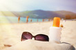 Sunglasses and protection lotion on the beach of Phuket island,