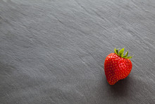 One Single Ripe Red Strawberry...