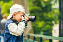 Little Boy With Photo Camera M...