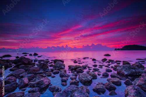 Poster Prune Slow shutter seascape view black stone in beautiful sunrise