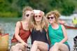 three young women make tourism