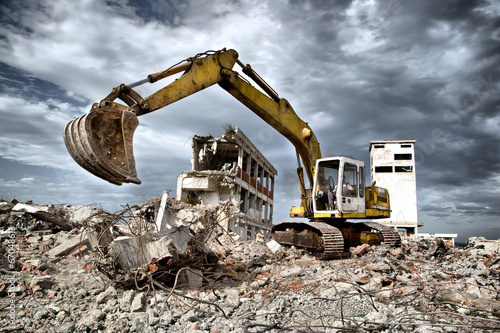 Bulldozer removes the debris from demolition of old buildings Canvas Print