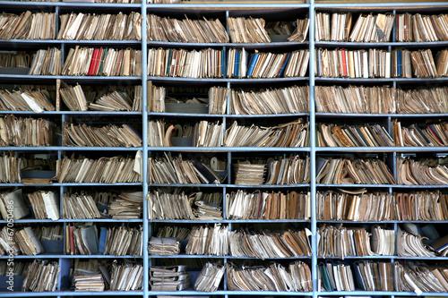 Fotografie, Obraz  shelves full of files in an old archive