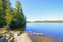 Clear Day And A Calm Lake In The North Woods