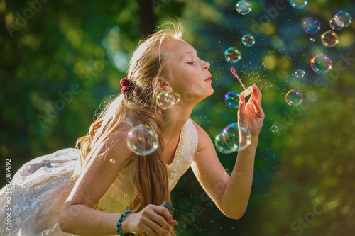 Poster Artist KB The young blonde blows soap bubbles