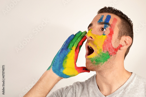 Fotografie, Obraz  Young man screaming with hand painted face