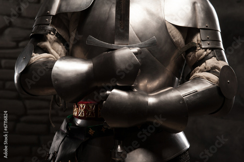 Closeup portrait of medieval knight in armor holding a sword Poster