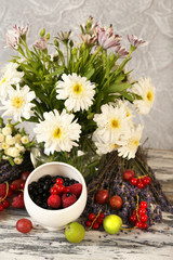 FototapetaStill life with flowers and fruits on table