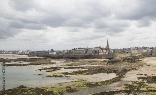 Fototapeta view of the shore from saint malo on a cloudy day obraz na płótnie