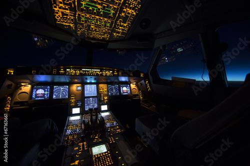 Fotografie, Obraz  Kokpit letadla při východu nebo západu slunce