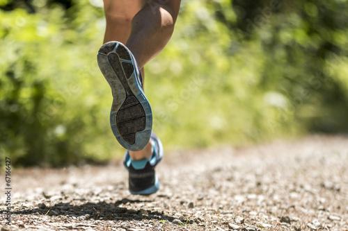Leinwand Poster Läuferbeine eines Triathleten