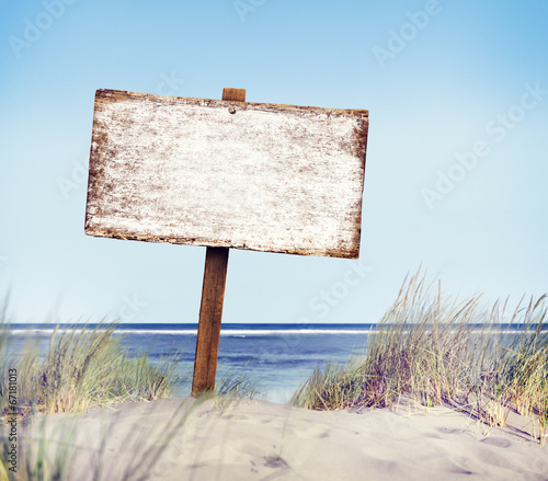 In de dag Lichtblauw Beach with Empty Plank Sign