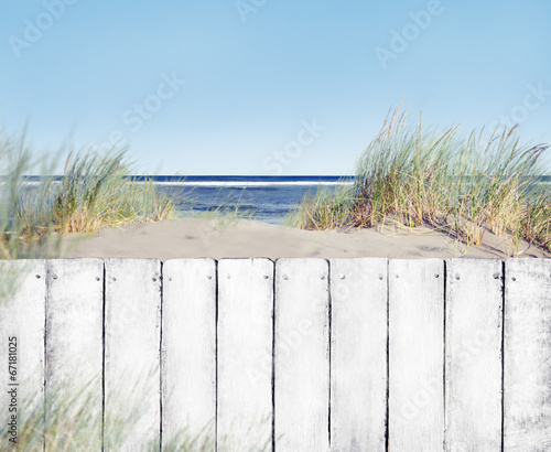 Staande foto Strand Beach and White Wooden Fence