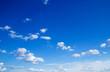 Leinwandbild Motiv blue sky background with tiny clouds