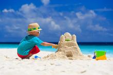 Child Building Sand Castle On Tropical Beach