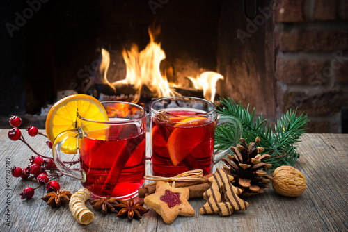Foto op Canvas Kerstmis Mulled wine at romantic fireplace