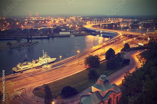 Vintage stylized picture of Szczecin (Stettin) City at dusk, Poland.