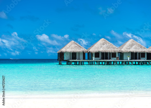 Fotografie, Obraz  Beautiful beach with water bungalows at Maldives