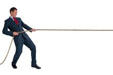 Businessman Pulling A Rope