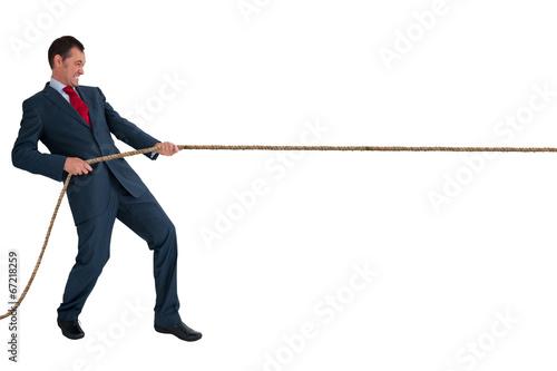 Fotografía  Hombre de negocios tirando de una cuerda