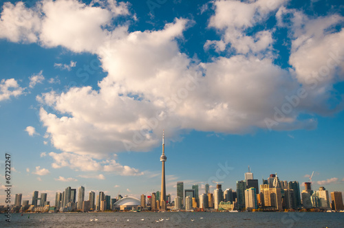 Stampa su Tela  Toronto city skyline at under blue sky