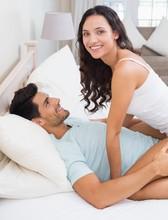 Attractive Brunette Straddling Boyfriend On Bed