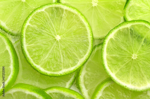 Fotografie, Obraz  lime slices in sparkling water