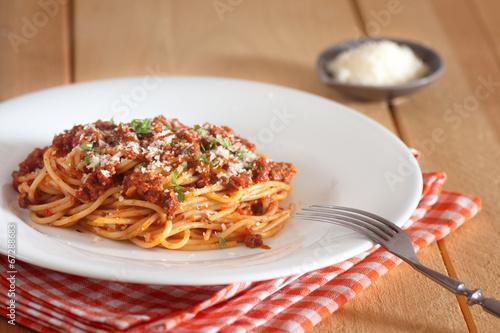 Fotografie, Obraz  spaghetti bolognese with red napkin