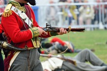 Redcoat Firing Musket In Re-en...