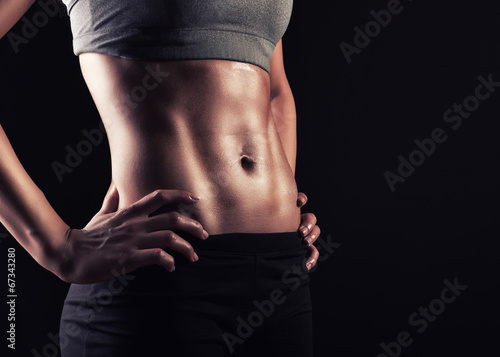 Cuadros en Lienzo  Strong woman abs show off