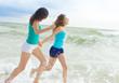 two young happy women enjoying life outdoors