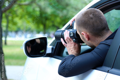 Fotografie, Obraz  Man in car with photo camera