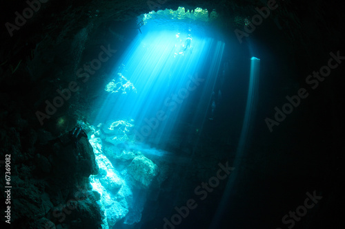 Fotobehang Koraalriffen Underwater cave with sunlight