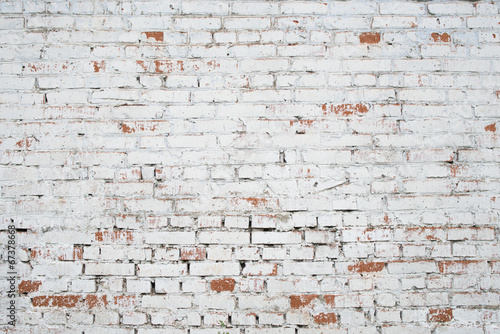 Fotobehang Baksteen muur Cracked white grunge brick wall textured background stained old