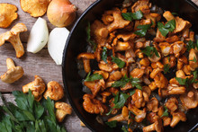 Chanterelle Mushrooms With Onion And Parsley  In A Pan Top View