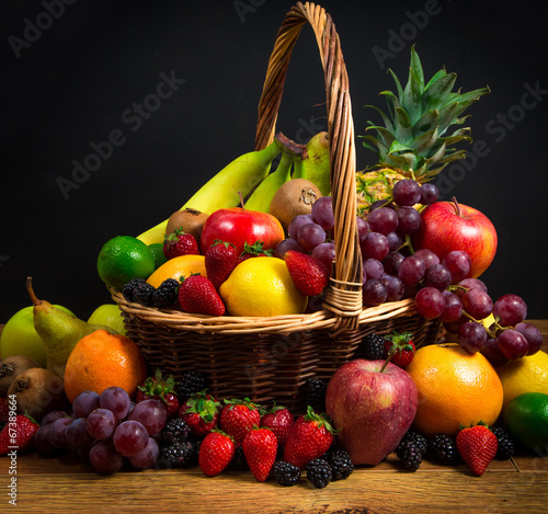 Mix of fresh fruits on wicker bascket Wall mural
