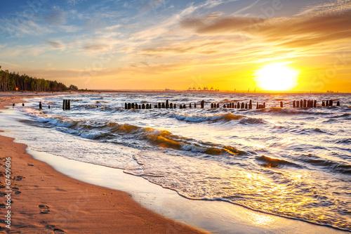 Fototapeta Sunset on the beach at Baltic Sea in Poland obraz