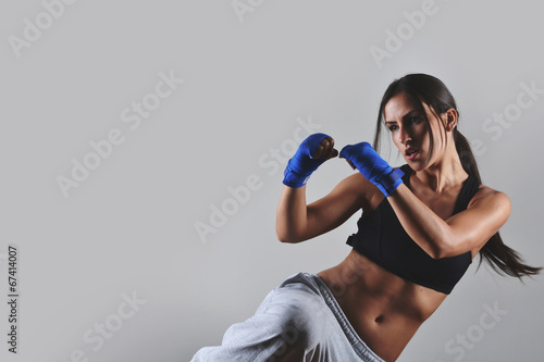 Tablou Canvas fitness woman with the blue boxing bandages, studio shot