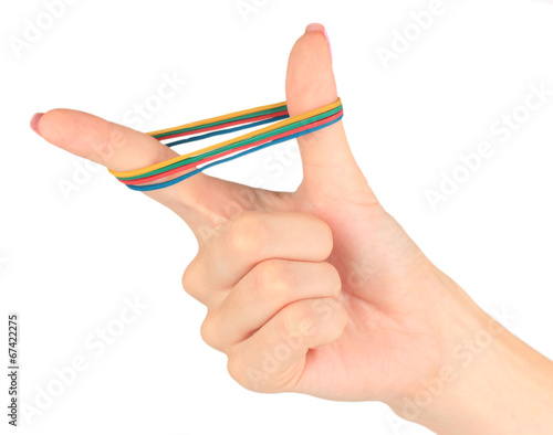 Fotografía  Colorful rubber bands in hand isolated on white