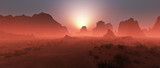 Red rocky desert landscape in the mist at sunset. Panoramic shot